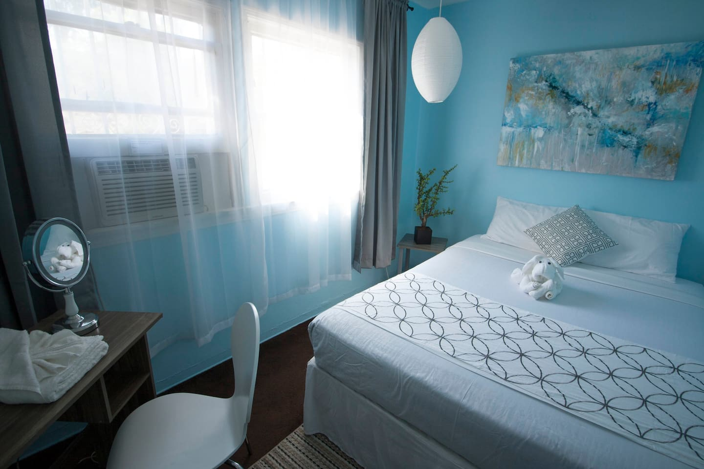 Comfortable private room with queen size bed, AC, and locking door.