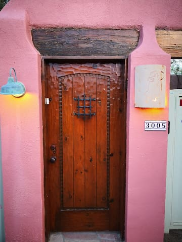 The separate wood entry door.
