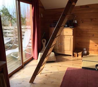 Chambre indépendante bois baie vitrée sur terrasse