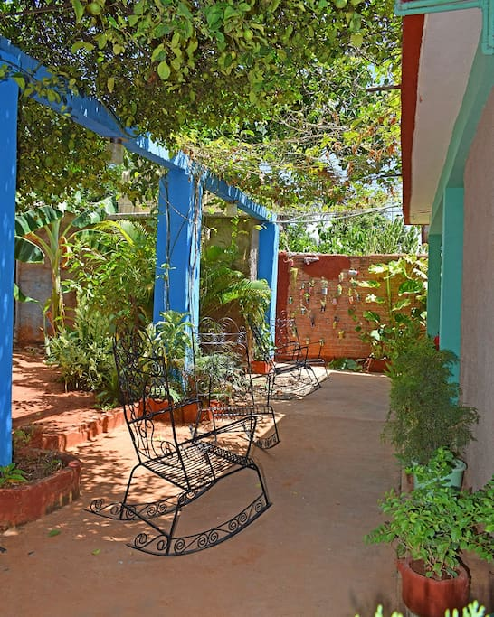 Enjoy our colorful terrace with good cuban coffee or a drink!
