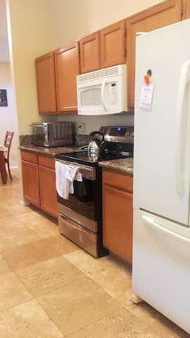 Fully equipped kitchen with all required appliances