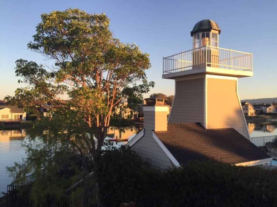 Evening light and close-up view of lighthouse from balcony.