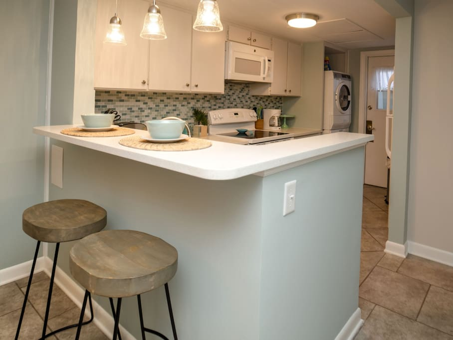 Seating for two at the breakfast bar, quartz counters, well equipped kitchen.