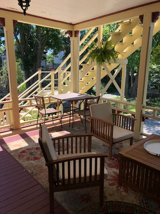 Private porch with sitting and dining areas.