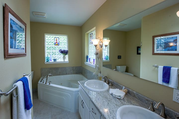 Full bath attached to Master Bedroom features double sinks and Jacuzzi