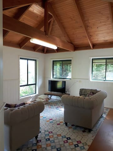 bright and fresh lounge, enjoy a wine overlooking trees or watch a movie