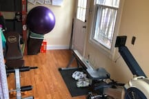 Small home gym--rowing  machine, hand weights, yoga ball, etc.