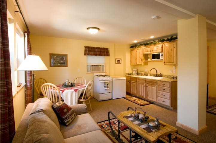 Full Kitchen with dishes, silverware, coffee pot and breakfast with hot waffles and more