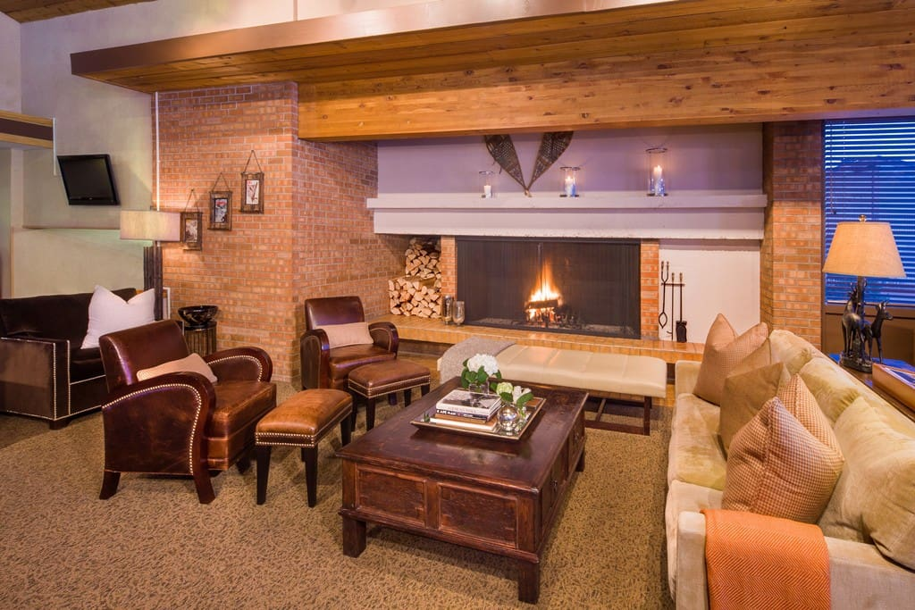 Guest area with wood burning fireplace and ample seating for lots of guests