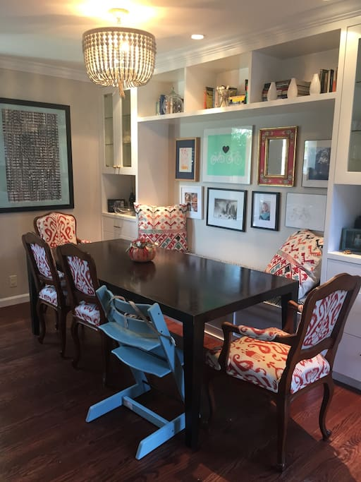 Dining room with custom built-ins and art.