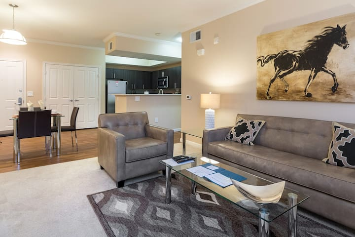 Spacious comfortable living room with pullout sofa bed and club chair