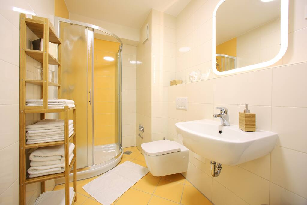 The bathroom is spacious, well lit and meticulously clean. It comes with towels and complimentary shampoo/shower gel.