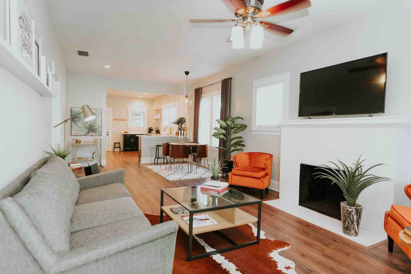 """Spacious living area with new furnishings from West Elm and World Market.  55"""" 4K smart Roku tv with local channels, Netflix, ESPN and more."""