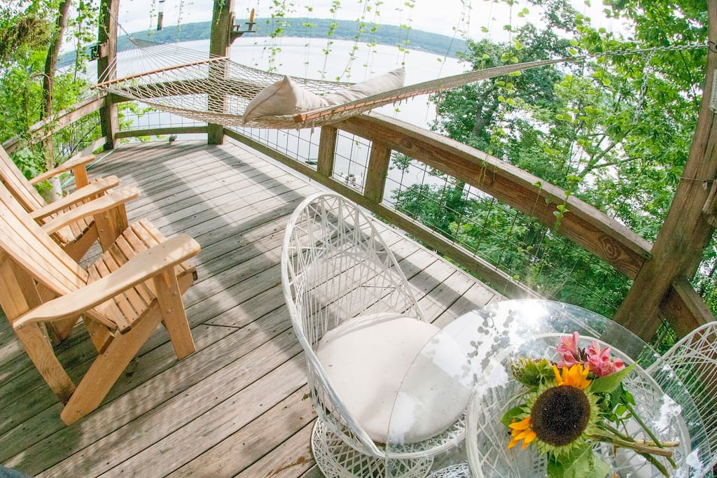 Wide-angle view of private deck with hammock.