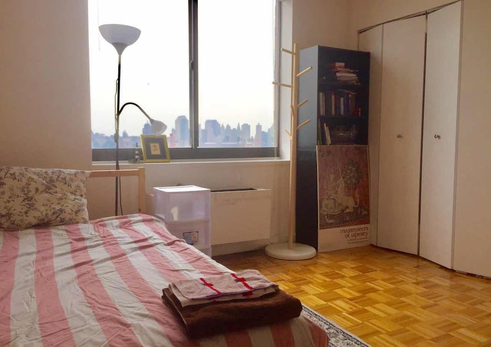 Comfortable Double Bed with intimate reading light, bedside drawer/table.
