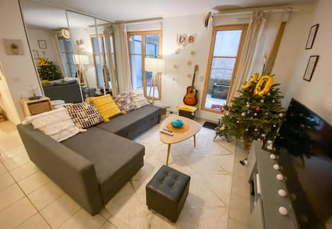 Grand appartement moderne et calme avec jardin.