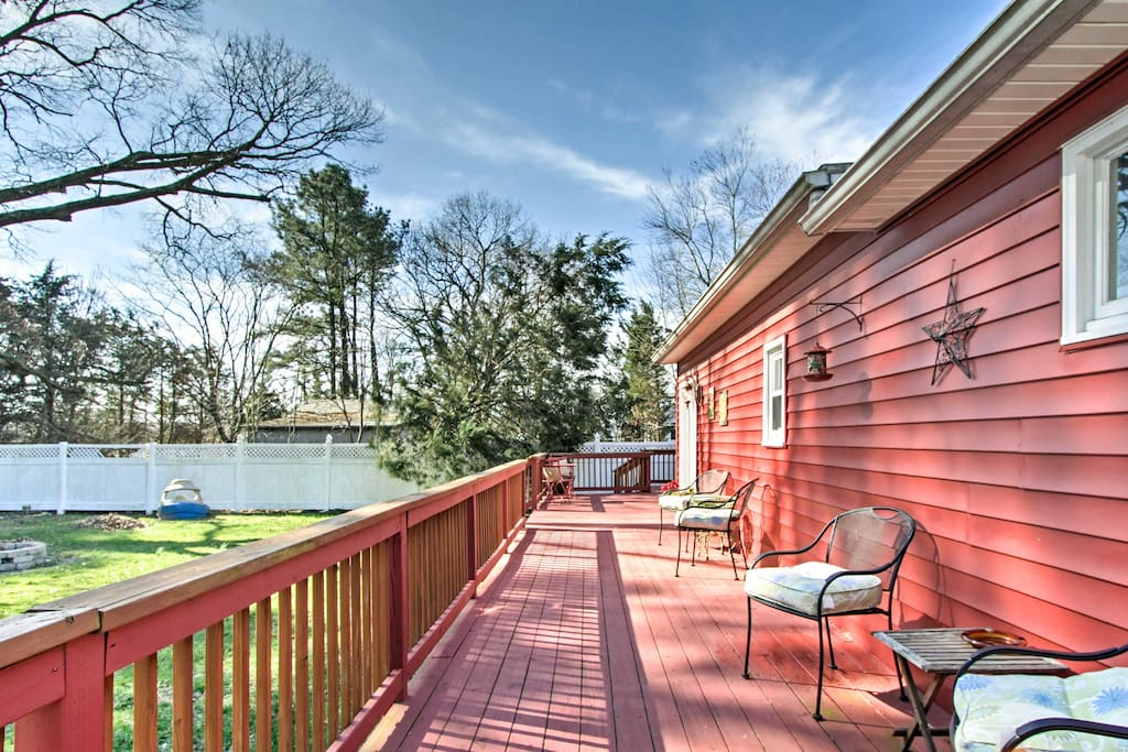 This home boasts a beautiful backyard with a large deck as your cozy outlook!
