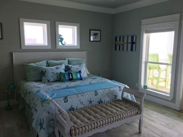 Turtle king bedroom with door to balcony