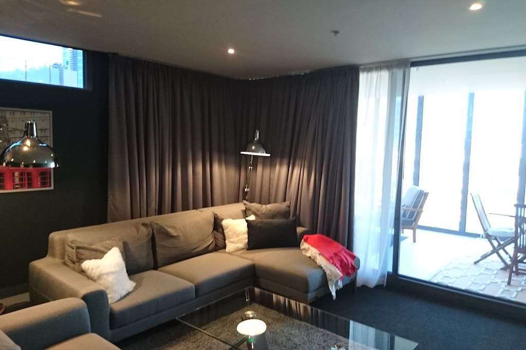 Spacious lounge and dining area with flatscreen TV