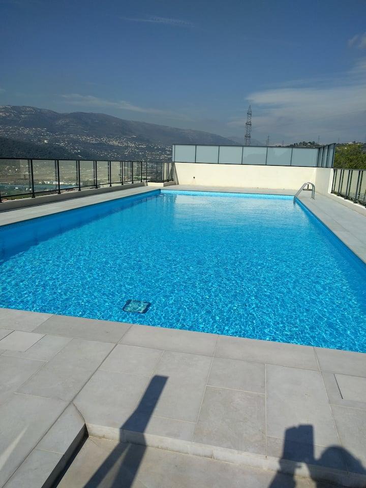 Studio neuf avec jardin et piscine