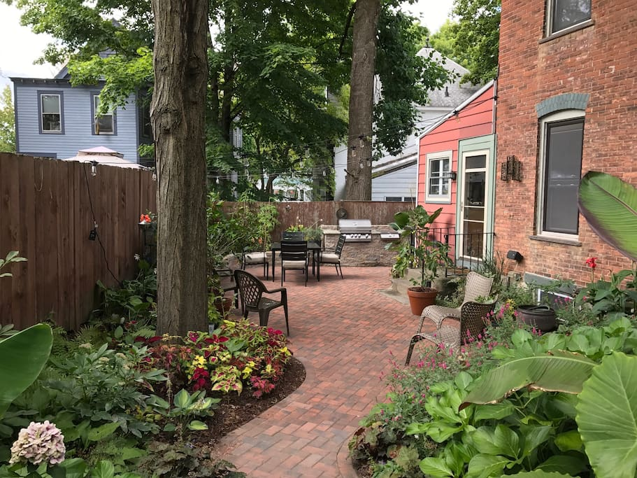 We love to garden and welcome you to share our brick patio with multiple seating areas.