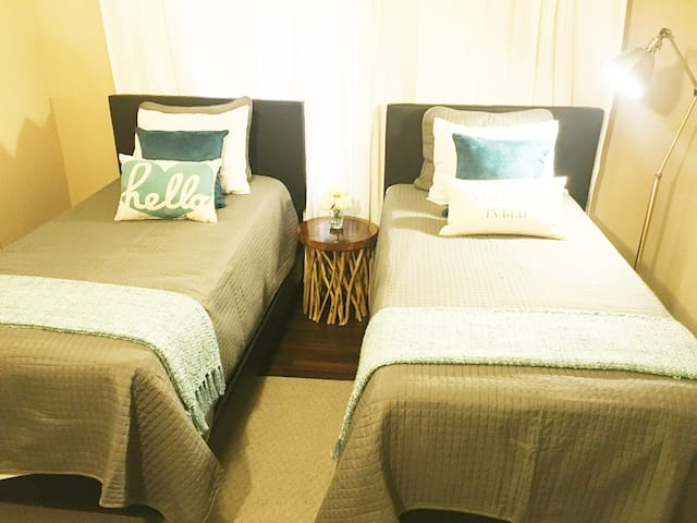 Twin beds with great reading lights and comfy bedding