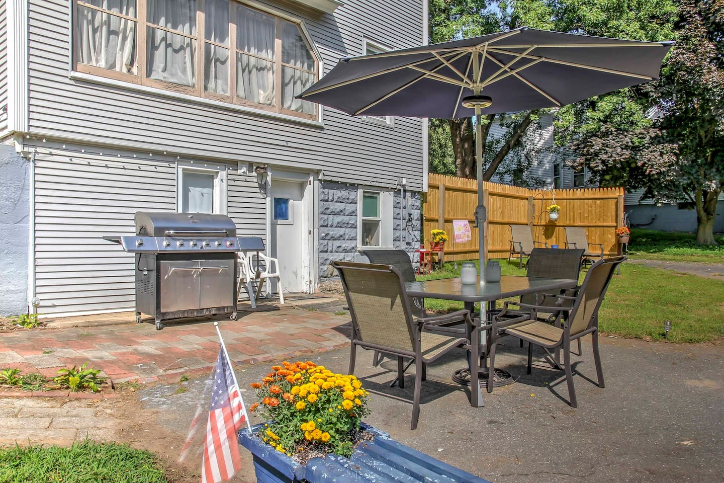 Fire up the grill for a BBQ, and enjoy in the shade of the patio table umbrella!