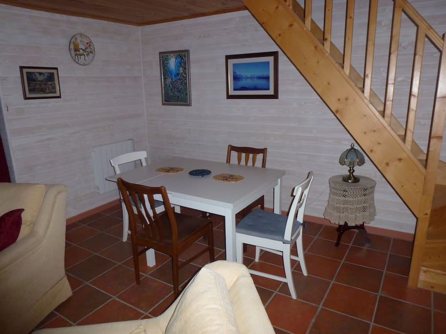Gite dining area and stairs to family bedroom.
