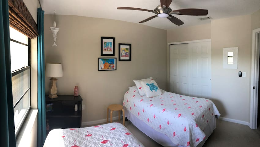 Twin beds and closet space in second bedroom.
