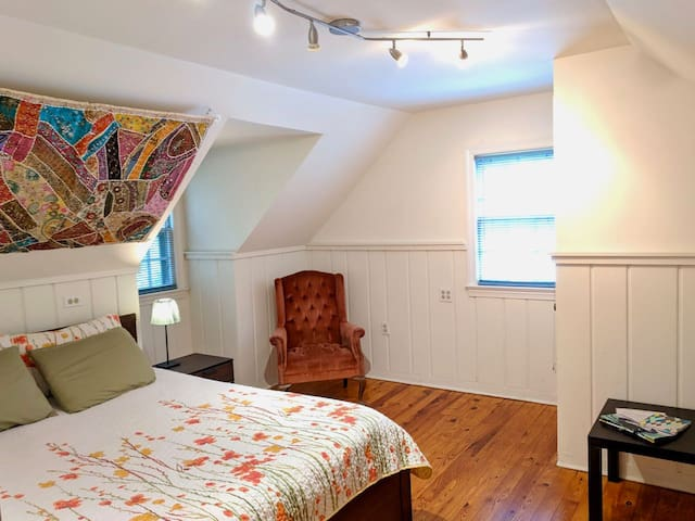 The master bedroom has a queen-sized bed, two closets, and a nice chair to read in.