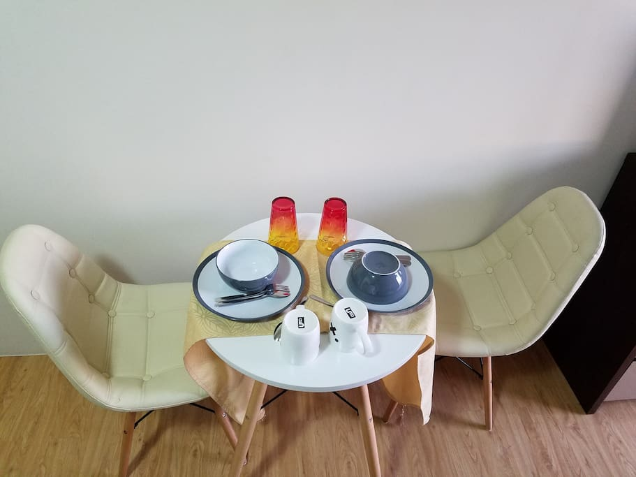 Modern and Trendy Breakfast and Cofee Table Complete with placemats, coffee mugs, glasses, soup bowls, plates, utensils and very comfortable leather chairs
