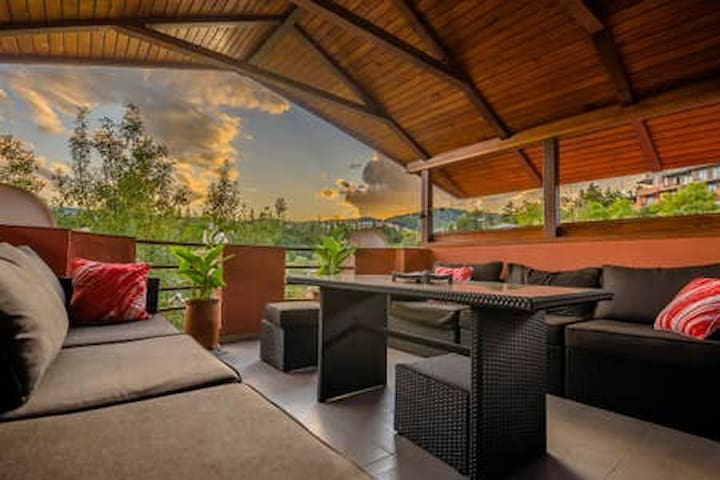 Relax on the rooftop, covered terrace sipping your favorite beverage and admiring stunning mountain views all around!