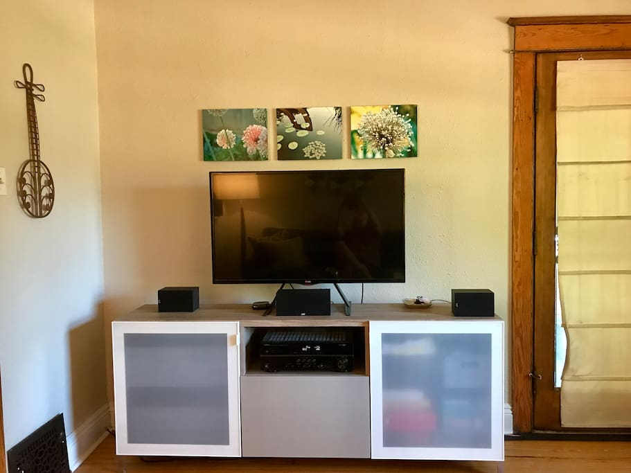Large television with surround sound in living room