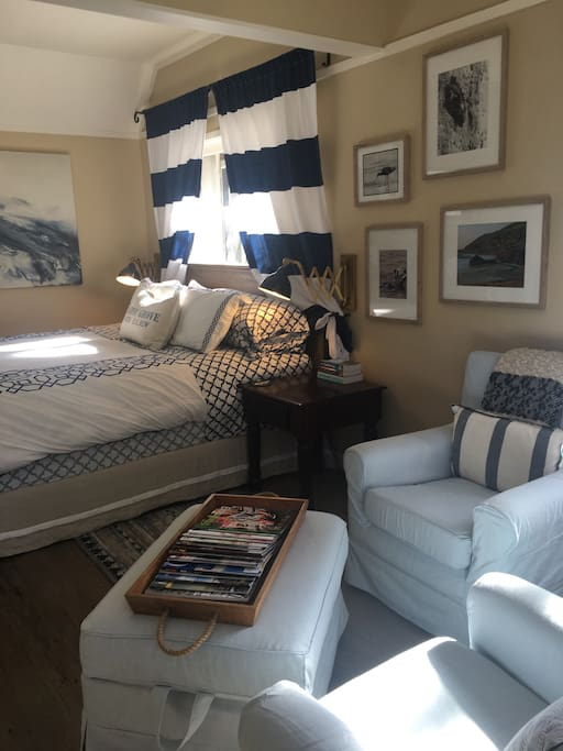 Standing at the front door, you see the king-sized bed and seating area to the right.  Beach chairs are stashed under the bed.