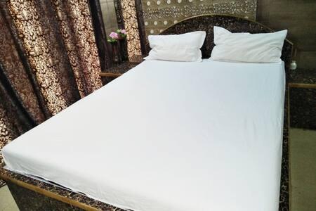 Royal room in Royal Palms Aarey colony