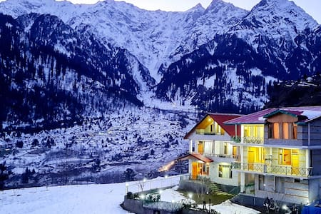Luxury Attic Room at Clifftop Cottages, Manali.