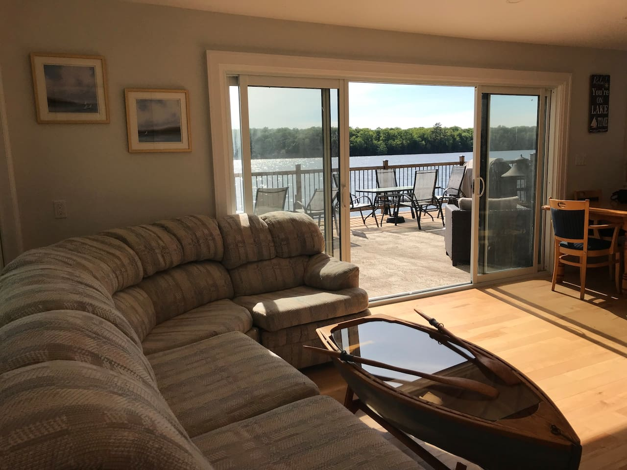 BALSAM LAKE GEM This beauty sits on a point with stunning views from inside the cottage or from the huge patio that cantilevers over the water Park your boat at our dock or use the canoe or tandem kayak provided Clear sandy bottom for swimming