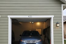 You will enter apartment from garage where you will park.  Larger trucks may not be able to fit here, in which case you can unload and park car in front.  There is a keypad located on the Right.  Code will be sent the day of your arrival.