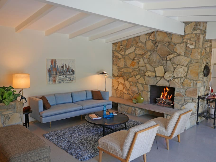 Massive stone fireplace dominates the living room