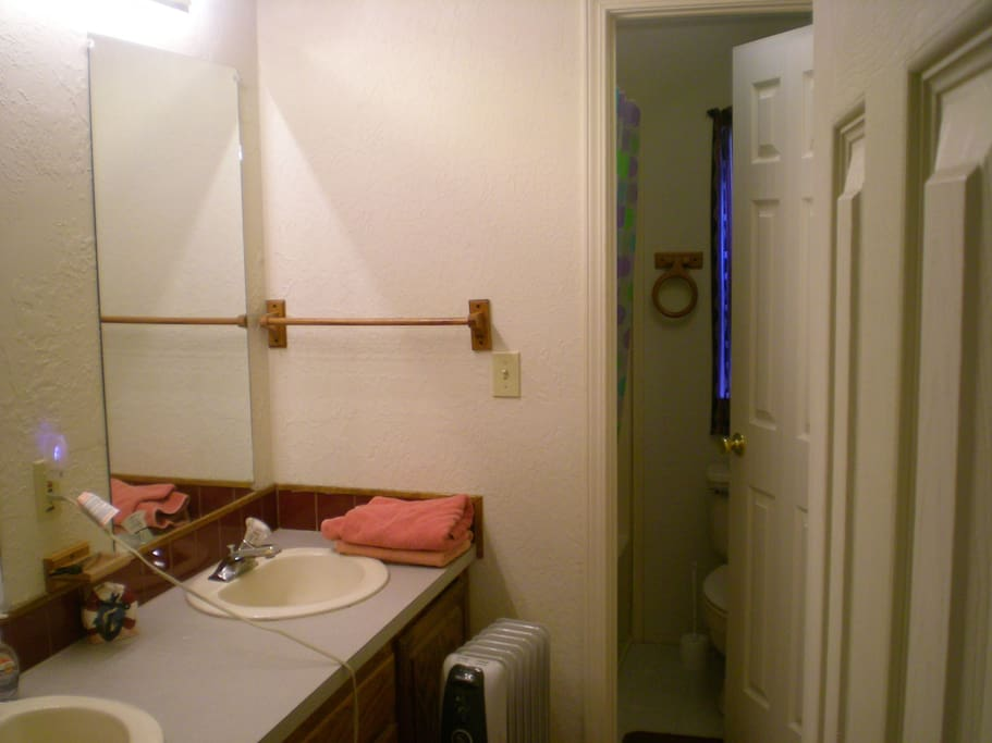Shared bath, connected to another room with locks on the doors.