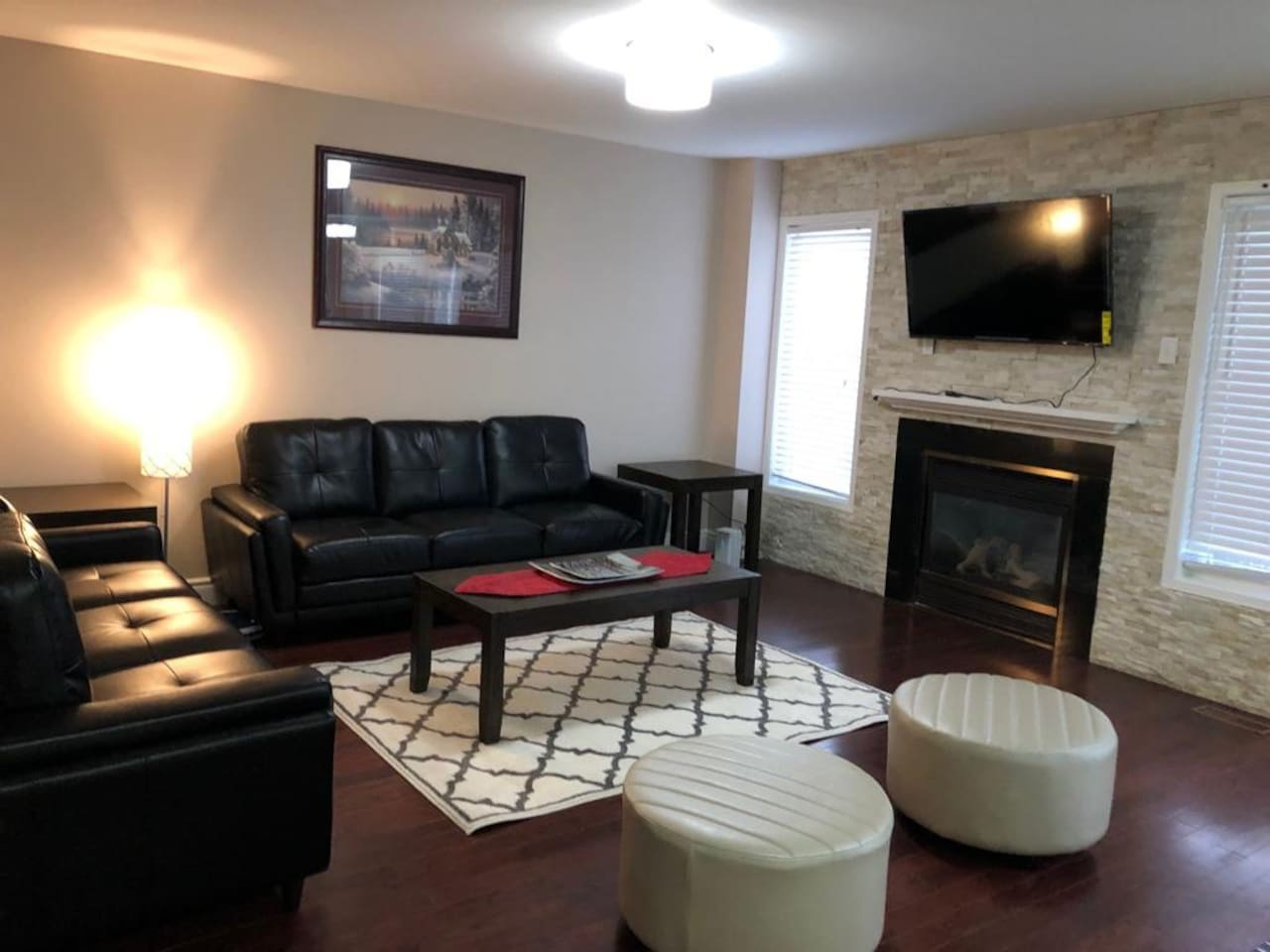 Enjoy family fun in the generously-sized family area graced by a fireplace, huge windows and glass sliding doors that lead out to the patio.