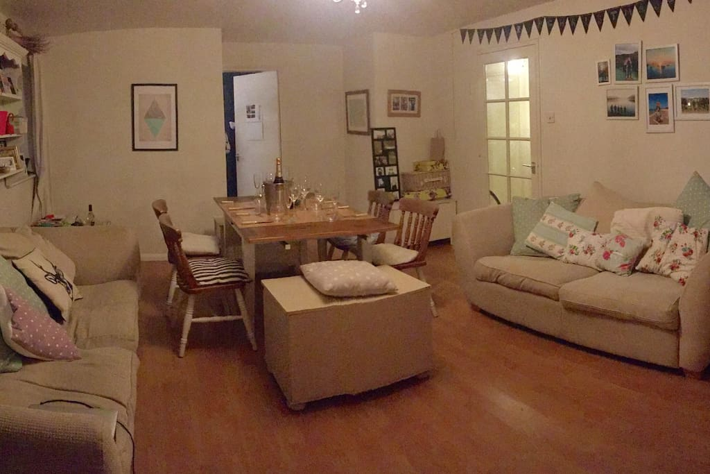 Spacious lounge and dining area with two large sofas