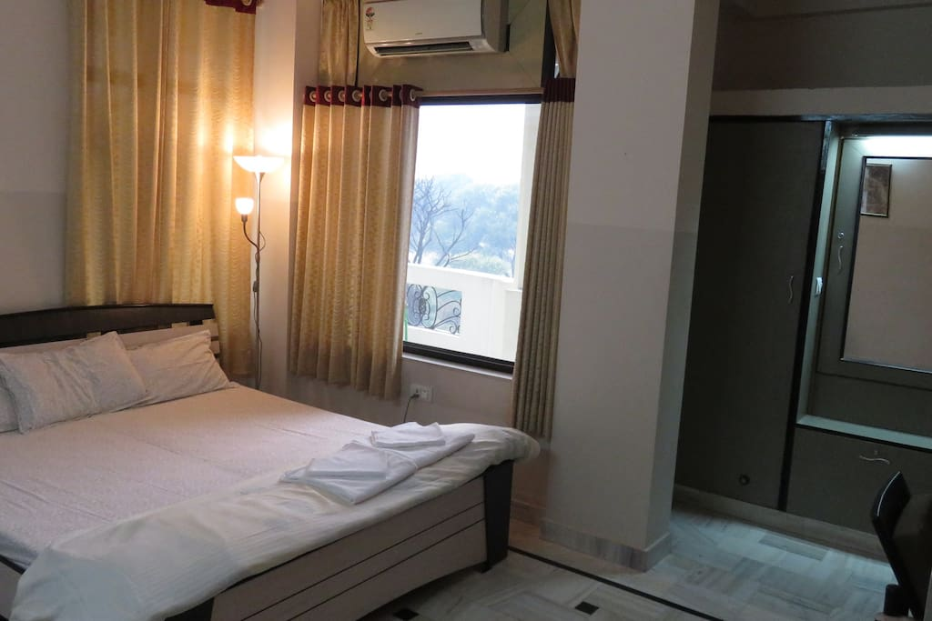 Room with attached balcony