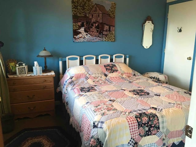Double bed in private bedroom includes both closet and drawer space.