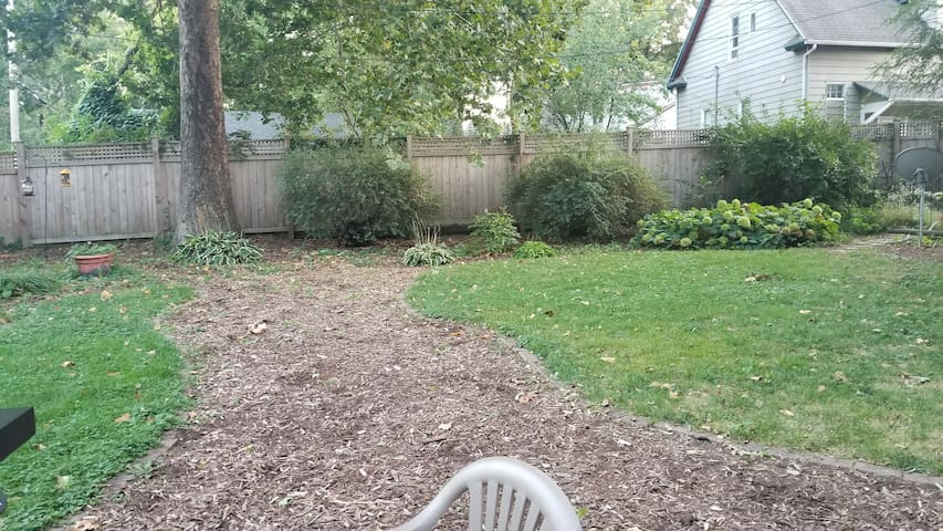 large private yard with gas grill