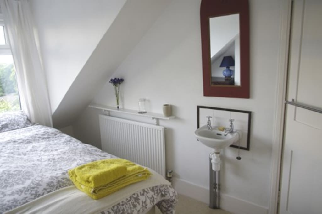 Bedroom image including radiator and small sink
