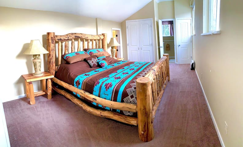 Sleep like a baby in this big comfy bed, and wake up to beautiful views out your bedroom windows.