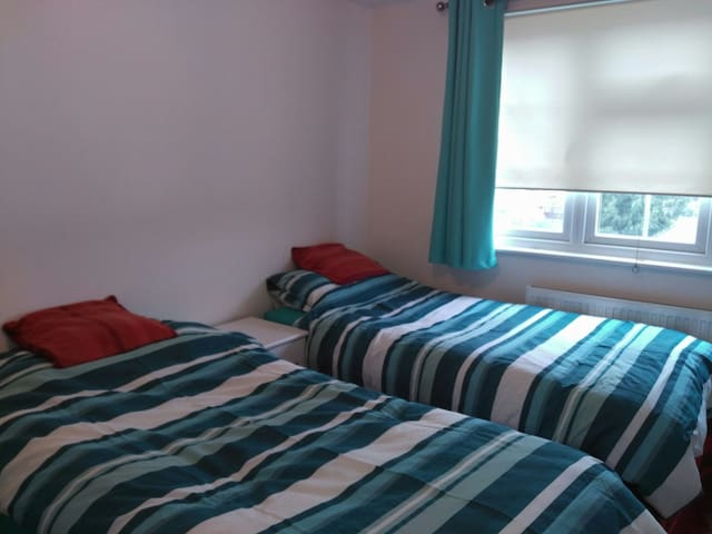 2 single beds in warm family home