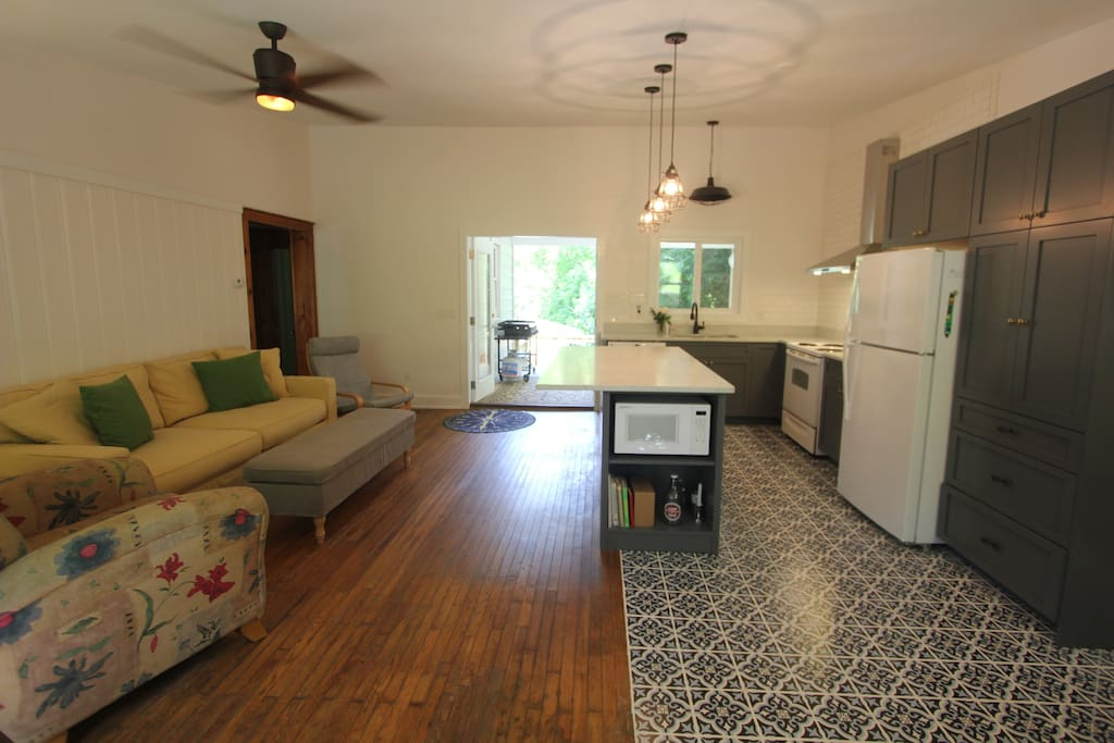 1941 cottage with original hardwood floor. Open living room with plush Restoration Hardware couch.