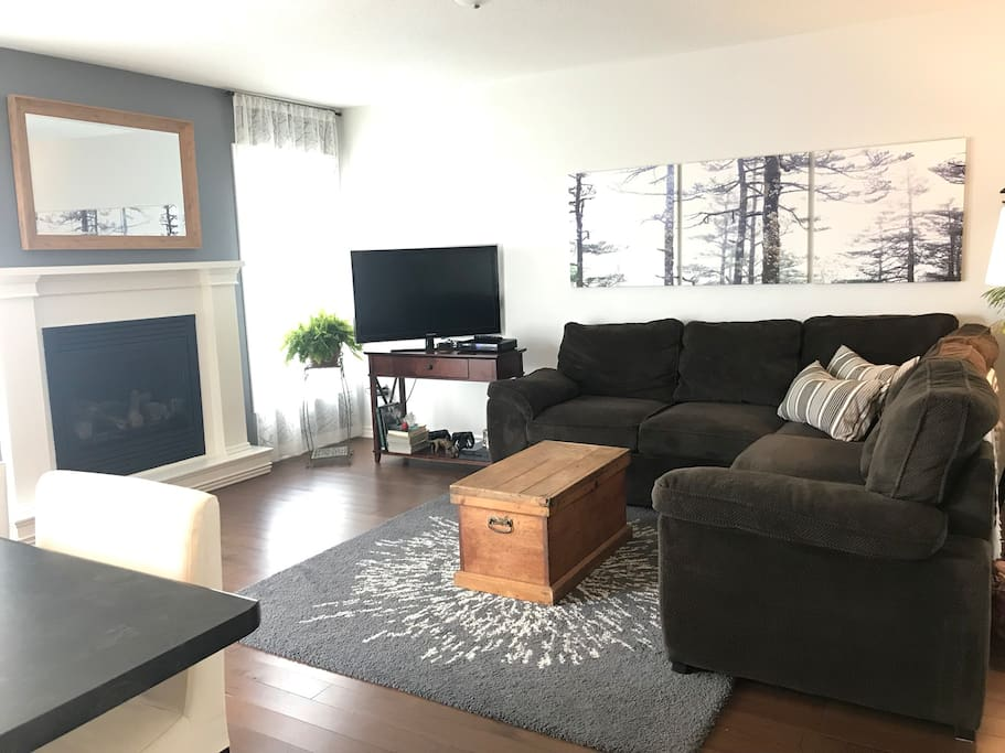 Family room with large sectional and gas fireplace